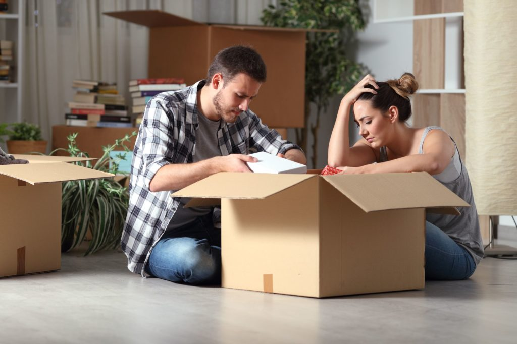 distraught couple moving house after loved one passing